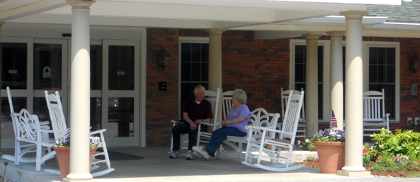 Bedford senior living residents chatting on the front porch
