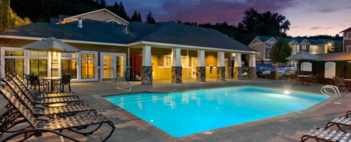 Night view of apartments in Renton swimming pool