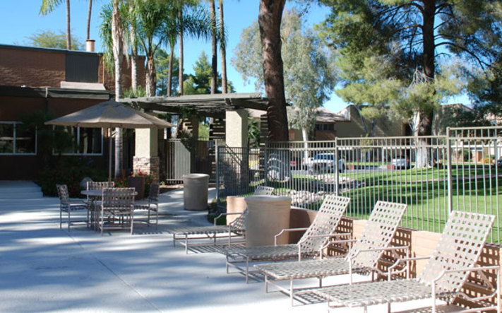 Hang out on the pool deck at apartments in Tucson